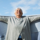 Composite image of happy elder woman raising her arms up - PhotoDune Item for Sale