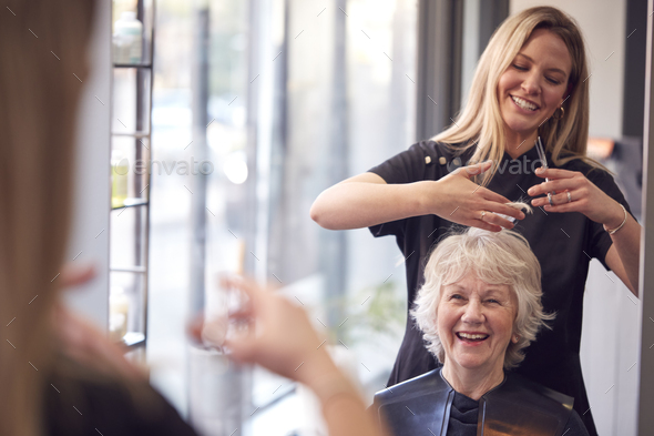Senior Woman Having Hair Cut By Female Stylist In Hairdressing Salon - Stock Photo - Images