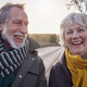 Portrait Of Loving Senior Couple Enjoying Autumn Or Winter Walk Along Country Road Together - PhotoDune Item for Sale