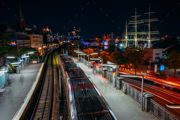 Landungsbruecken in Hamburg during night. Panorama of Harbor and metro station, Germany. Light - Stock Photo - Images