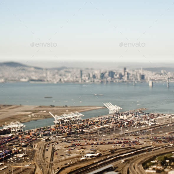 Aerial view of freight harbour with San Francisco skyline. - Stock Photo - Images
