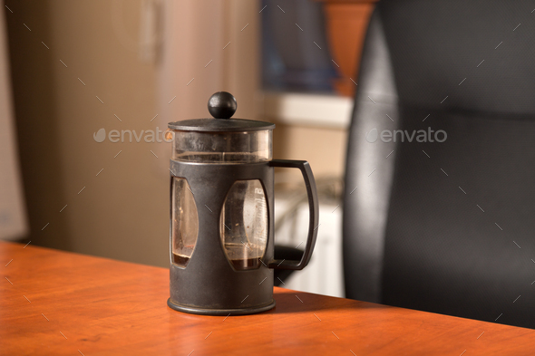 A coffee press for your pleasure at work. The perfect solution for your office staff. - Stock Photo - Images