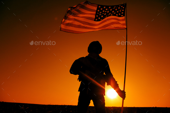 American soldiers with national flag silhouette - Stock Photo - Images