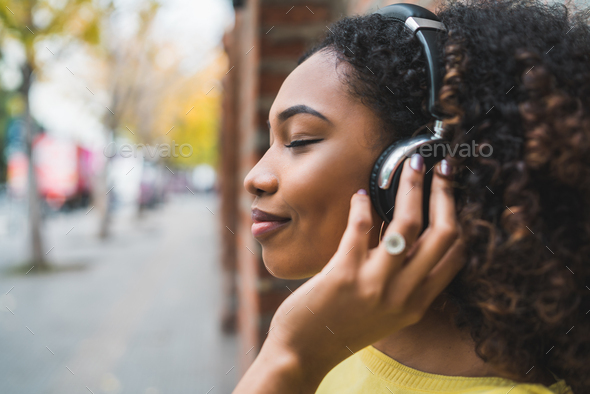 Afro american woman listening music - Stock Photo - Images