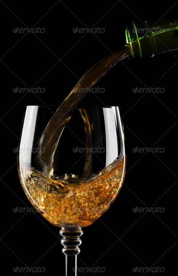 pouring wine into glass isolated on black - Stock Photo - Images