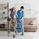 Nurse helping to senior man walking at home, recovering after injury - PhotoDune Item for Sale
