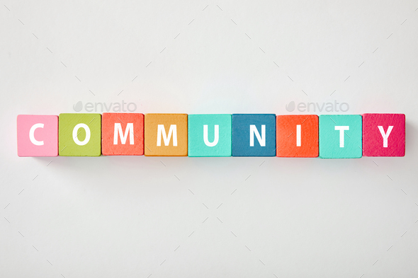 top view of community lettering made of multicolored cubes on grey background - Stock Photo - Images