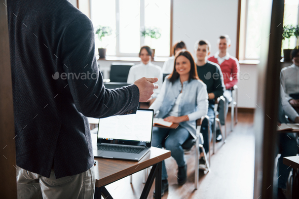 Cheerful mood. Group of people at business conference in modern classroom at daytime - Stock Photo - Images