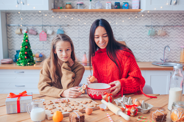 Happy family mother and daughter bake cookies for Christmas - Stock Photo - Images