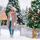 Happy girl near fir-tree branch in snow for new year - PhotoDune Item for Sale