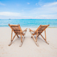 White lounge chairs on a beautiful tropical beach - PhotoDune Item for Sale