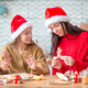Happy family mother and daughter bake cookies for Christmas - PhotoDune Item for Sale