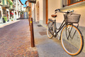 Bicycle on the street of Alba, Italy. - PhotoDune Item for Sale