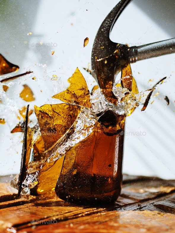 Old glass bottle shattered by hammer - Stock Photo - Images