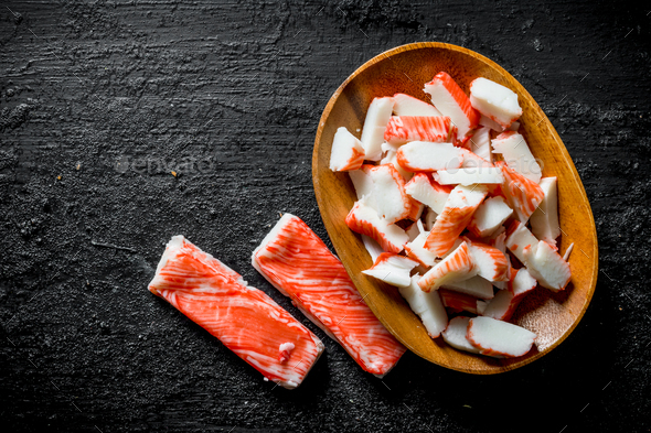 Sliced crab sticks on a plate. - Stock Photo - Images