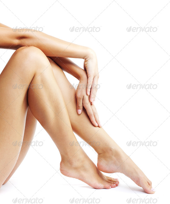 Woman's legs isolated on white background - Stock Photo - Images