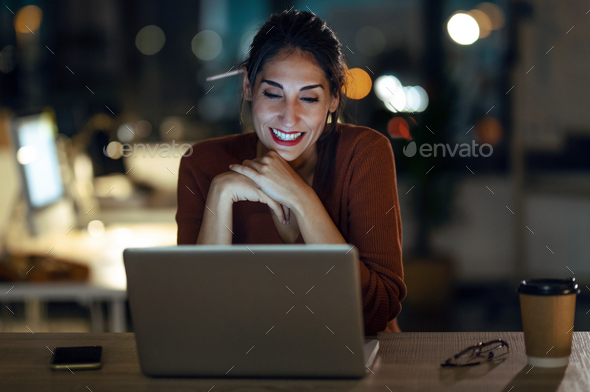Smiling beautiful business woman having an online video call via laptop computer in the office. - Stock Photo - Images