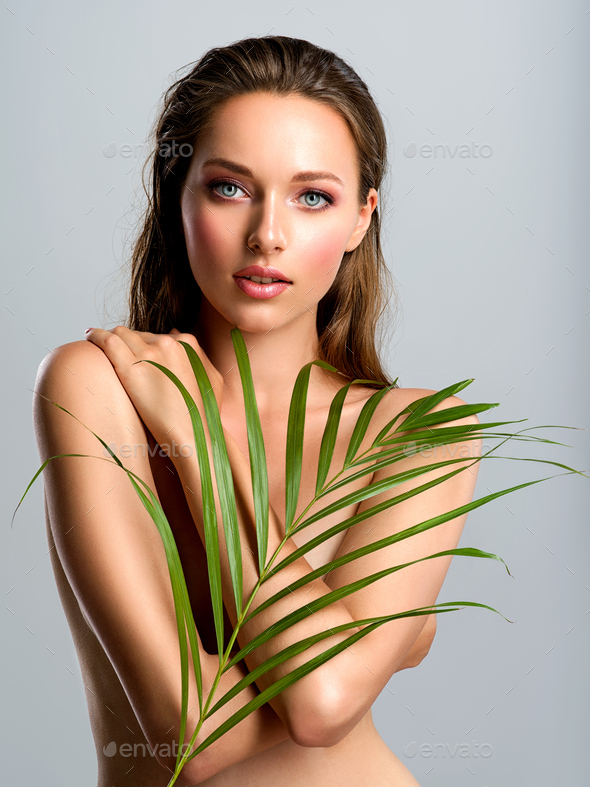 White woman with healthy skin of body and palm leaves. - Stock Photo - Images