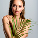 White woman with healthy skin of body and palm leaves. - PhotoDune Item for Sale