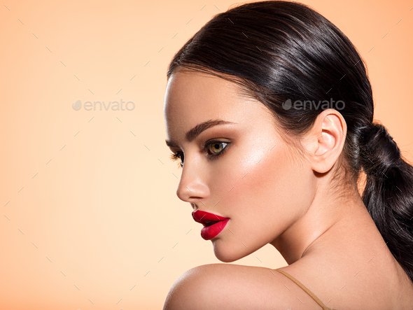 Beautiful white girl with a red lipstick on lips. Stunning brunette girl with long black hair. - Stock Photo - Images