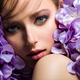 Pretty woman with bright makeup. Beautiful white girl with purple flowers. - PhotoDune Item for Sale