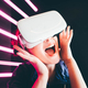 Girl using VR goggles in colorful neon lights - PhotoDune Item for Sale