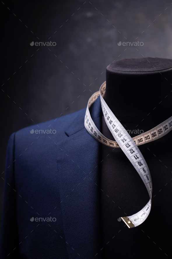 suit jacket on male tailor mannequin - Stock Photo - Images