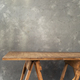 wooden table near concrete wall background - PhotoDune Item for Sale
