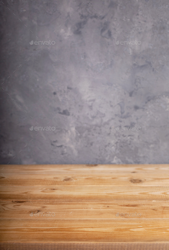 wooden desk table or shelf near grey concrete wall - Stock Photo - Images