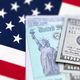 United States IRS Check, Envelope and Money Resting on American Flag - PhotoDune Item for Sale