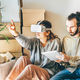 couple planning interior design in virtual reality. - PhotoDune Item for Sale