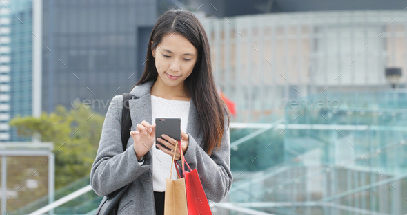 Woman use of mobile phone in city - Stock Photo - Images