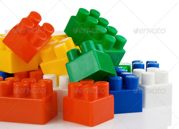 colorful plastic toys bricks isolated on white - Stock Photo - Images