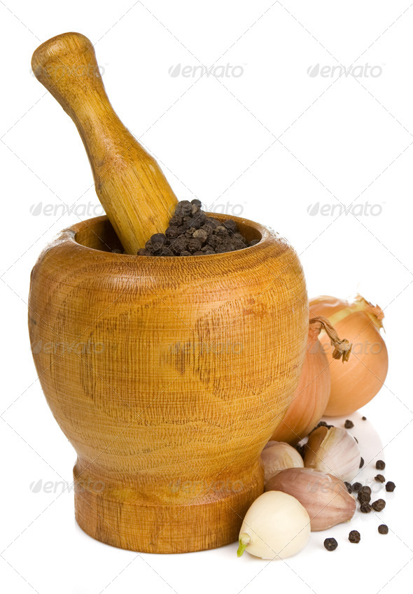garlic, onion and pepper in mortar and pestle on white - Stock Photo - Images