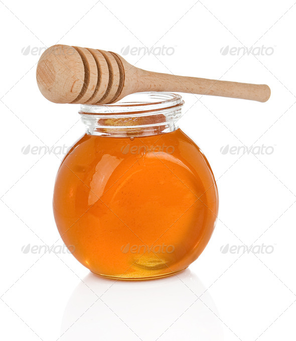 glass pot full of honey on white - Stock Photo - Images