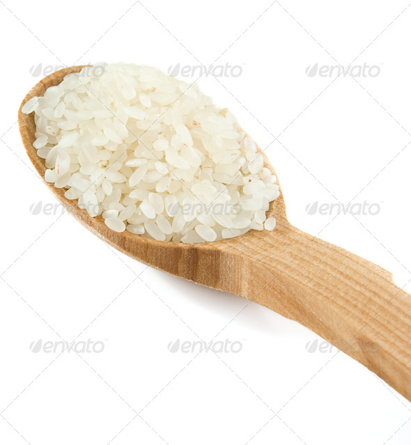 rice grain in wooden spoon isolated on white - Stock Photo - Images
