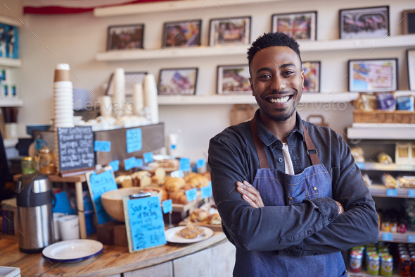 Portrait Of Smiling Male Owner Of Coffee Shop Standing By Counter - Stock Photo - Images