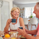 Retired Couple At Home In Kitchen Eating Breakfast Together - PhotoDune Item for Sale