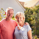 Portrait Of Loving Retired Couple Working In And Enjoying Summer Garden At Home - PhotoDune Item for Sale