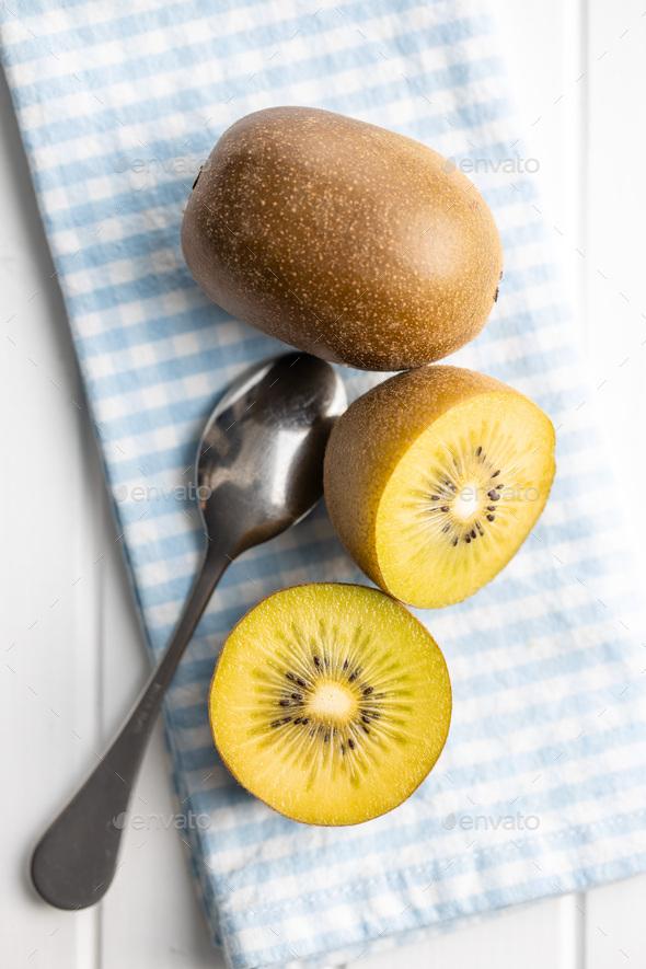 Halved ripe yellow kiwi fruit. - Stock Photo - Images