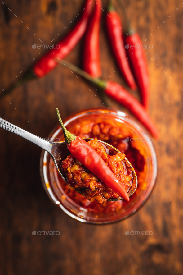 Red hot chili paste and chili pepper - Stock Photo - Images