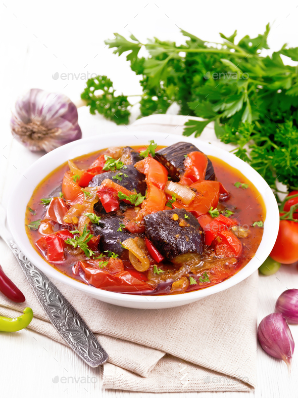Ragout vegetable with eggplant on wooden board - Stock Photo - Images