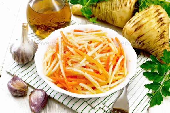 Salad of parsnip and carrot on napkin - Stock Photo - Images
