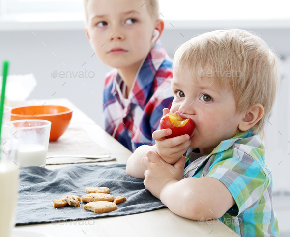 Brothers by the table - Stock Photo - Images