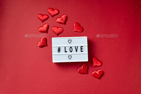 Love lightbox message with red hearts on red background - Stock Photo - Images