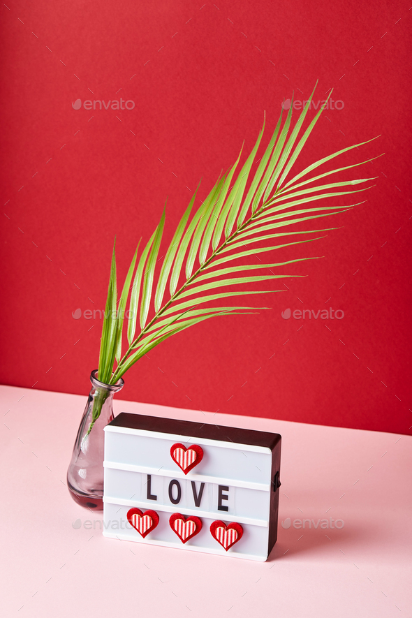 Love lightbox message with red hearts on pink and red background - Stock Photo - Images