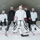 Professional hockey players and their trainer in sports uniform and skates - PhotoDune Item for Sale