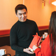 Beautiful young asian couple in red clothes give present in festive chinese vietnamese restaurant - PhotoDune Item for Sale