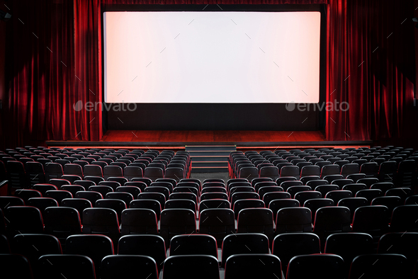 Auditorium of an empty movie theatre and stage - Stock Photo - Images
