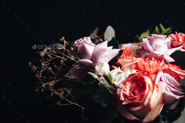 Large beautiful bouquet of mix flowers on black background. - Stock Photo - Images